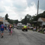 People lined the roads to watch the parade vehicles move along