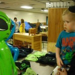 Stan's grandson Peyton, checks out the alien visitor at the festival