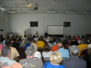Stan (left) being introduced by Ron Struble to speak at the 2013 Kecksburg UFO Conference at the annual festival.